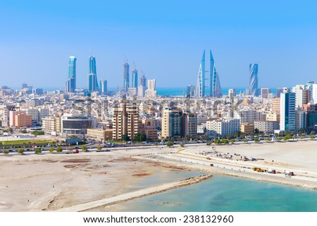 Bird view of Manama city, Bahrain. Skyline with modern skyscrapers standing on the coast of Persian Gulf - stock photo
