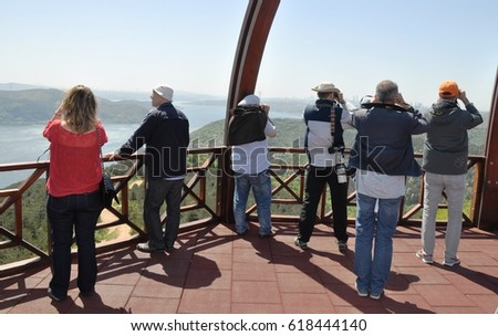 Bird watchers . they are recording migratory birds, on the Bosphorus. Istanbul, Turkey, 2016.