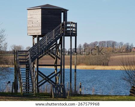 Bird watching birding wildlife observation tower in a nature park - stock photo