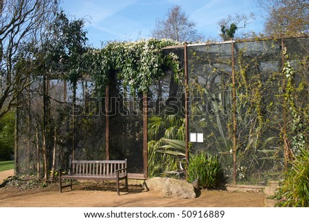 birdcage with plant inside them  in a zoo