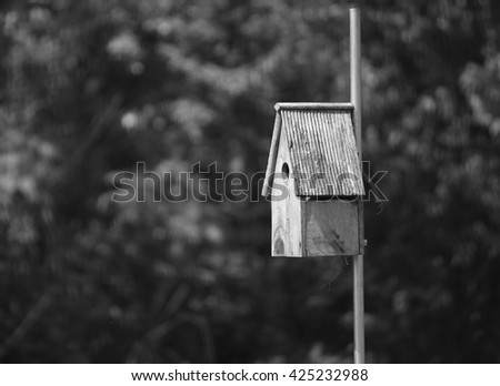 Birdhouse shot in black and white - stock photo