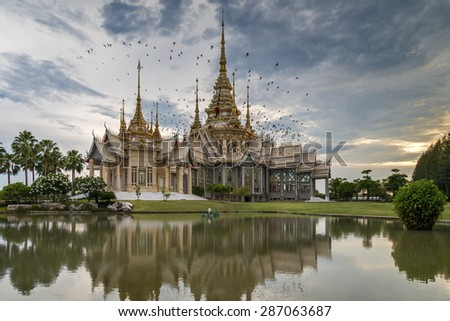 Birds circling above William Temple Wat Non Kum Thailand .