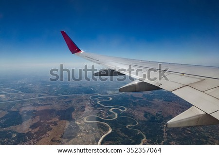 Birds eye. View from window of plane airplane - stock photo
