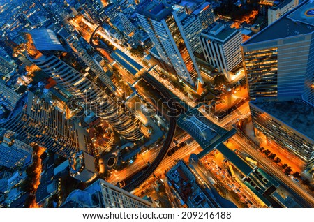 Birds eye view of a modern building at night. Traffic in the business district The Skytrain station Chong Nonsi - stock photo