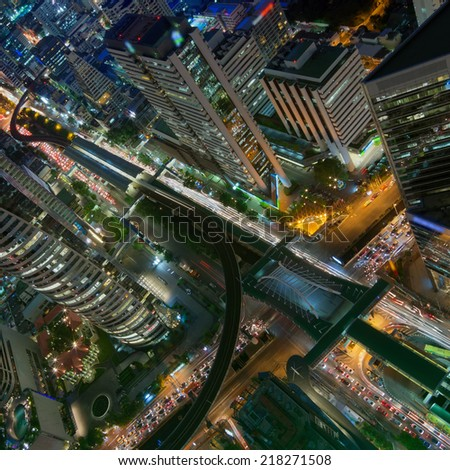 Birds eye view of a modern building at night. Traffic in the business district The Skytrain station Chong Nonsi