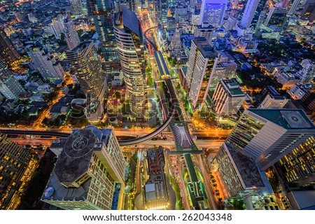 Birds eye view of Bangkok city night with a modern building at . Traffic in the business district The Skytrain station Chong Nonsi - stock photo
