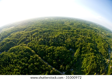 Birds eye view of earth from a hot air balloon - stock photo