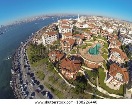 Birds eye view of luxury houses and a swimming pool at Uskudar, Istanbul. Looking down on a residential housing community. - stock photo