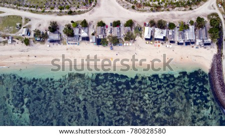 Birds eye view of Serangan beach, a famous surf break on the east coast of Bali, Indonesia. Crystal waters and a reef break making it very popular for not only experienced surfers but also beginners.