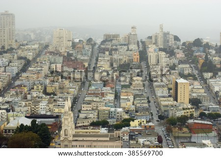 Birds eye view of the northern end of San Francisco near financial district under clouds or smog in winter - stock photo