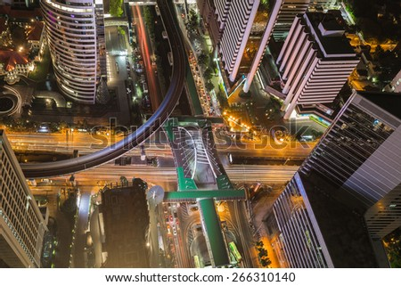 Birds eye view of Traffic in the business district, a modern building at night   - stock photo