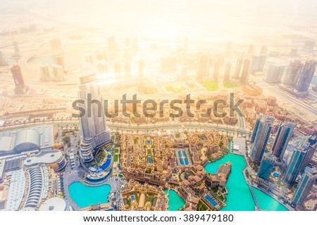 Birds eye view urban landscape from Burj with shining lights of the downtown business central area of the city of gold, Dubai, UAE - stock photo