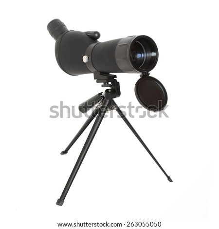 Birdwatching monocular or spotting scope on a tripod - stock photo