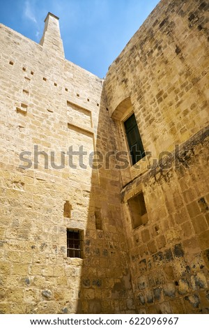 BIRGU, MALTA - JULY 25, 2015: The sandstone walls of the Inquisitor's Palace in Vittoriosa (Birgu), Malta.