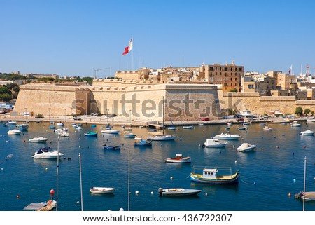 BIRGU, MALTA - JULY 26, 2015:  The view of Post of Castile from Kalkara over the Kalkara creek with the yachts and boats moored in the harbor.
