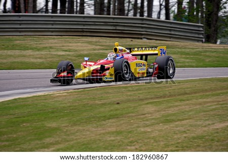 BIRMINGHAM, AL - APRIL 8, 2011: #34 Sebastian Saavedra (R) Colombia driving for Conquest Racing  Barber Motorsports Park. Bridgestone Presents IRL Indycar.