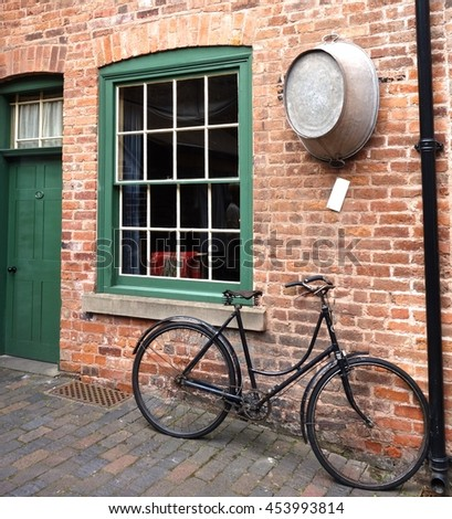 BIRMINGHAM, ENGLAND - JULY 4. The Birmingham Back-to-Backs are a block of Victorian dwellings which have been preserved and open to the public in the city centre. July 4 2016 in Birmingham, England. - stock photo
