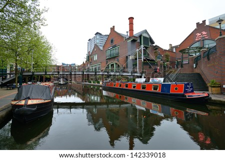 BIRMINGHAM, ENGLAND - JUNE 12: Colorful narrow boat, typical houseboats in West Midlands, England on June 12, 2013. Birmingham Canal is popular for leisure and has a number of narrow boat hire centers - stock photo