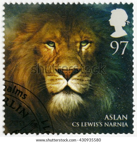 BIRMINGHAM, GREAT BRITAIN - MARCH 08, 2011: A stamp printed in Great Britain shows portrait of Aslan, Narnia, series Magical Realms - stock photo