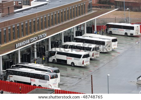BIRMINGHAM - MARCH 12: National Express coaches on March 12, 2010 in Birmingham, UK. According to their website, National Express is the largest scheduled bus operator in Europe. - stock photo