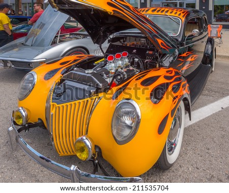 BIRMINGHAM, MI/USA - AUGUST 16, 2014: A 1930s Ford Hod Rod at the Woodward Dream Cruise, the world's largest one-day automotive event. Woodward is a National Scenic Byway and Michigan Heritage Route. - stock photo