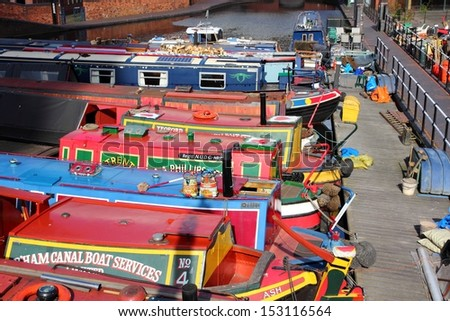 BIRMINGHAM, UK - APRIL 19: Narrowboats moored at Gas Street Basin on April 19, 2013 in Birmingham, UK. Birmingham is the 2nd most populous British city. It has rich waterway and boat culture. - stock photo