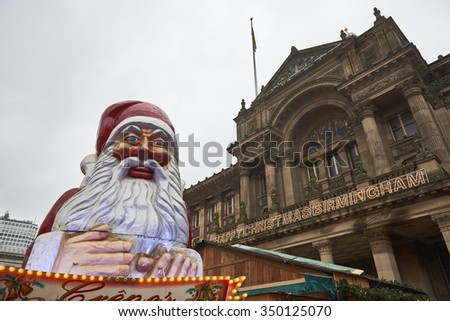 BIRMINGHAM, UK - DECEMBER 03: Santa Claus statue in Victoria Square with the Museum of Arts facade in the background. The statue was part of the Christmas market. December 03, 2015 in Birmingham. - stock photo