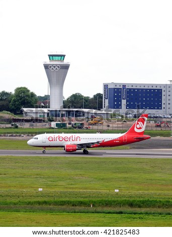 BIRMINGHAM, UK - JUNE 13, 2012 - Air Berlin A320 D-ABDW taxiing after landing with the new control tower to the rear at Birmingham Airport, Birmingham, England, UK, Western Europe, June 13, 2012.