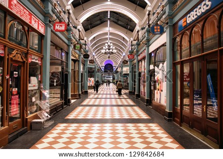 BIRMINGHAM, UK - MARCH 9: Great Western Arcade on March 9, 2010 in Birmingham, UK. The shopping gallery is a famous Grade II listed monument, built in 1875-76. - stock photo