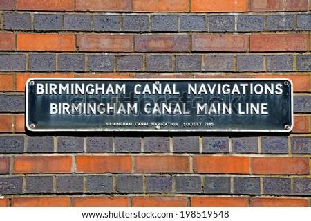 BIRMINGHAM, UK - MAY 14, 2014 - Birmingham Canal Main Line sign on a brick wall, Gas Street Canal Basin, Birmingham, West Midlands, England, UK, Western Europe, May 14, 2014. - stock photo