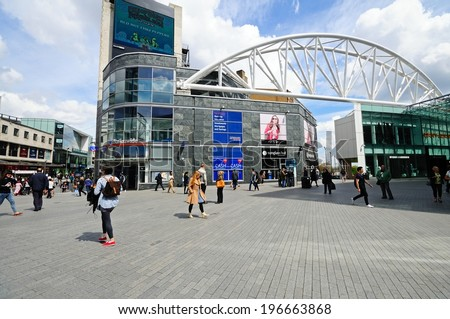 BIRMINGHAM, UK - MAY 14, 2014 - Shops along new street by the entrance to the Bullring shopping centre, Birmingham, West Midlands, England, UK, Western Europe, May 14, 2014. - stock photo