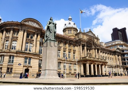 BIRMINGHAM, UK - MAY 14, 2014 - Statue of Queen Victoria with the Council House to the rear, Victoria Square, Birmingham, West Midlands, England, UK, Western Europe. - stock photo