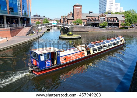 BIRMINGHAM, UNITED KINGDOM - JUNE 6, 2016 - View of The Malt House pub at Old Turn Junction with a tour boat in the foreground, Birmingham, England, UK, Western Europel, June 6, 2016.