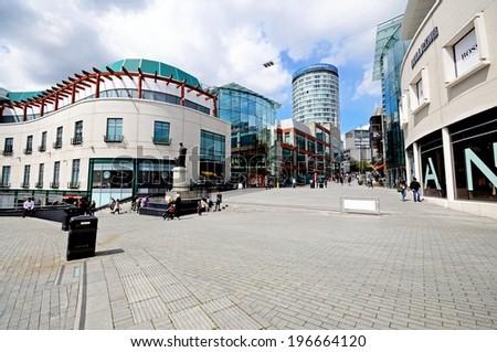 BIRMINGHAM, UNITED KINGDOM - MAY 14, 2014 - Bullring shops with the Rotunda to the rear, Birmingham, West Midlands, England, UK, Western Europe, May 14, 2014. - stock photo