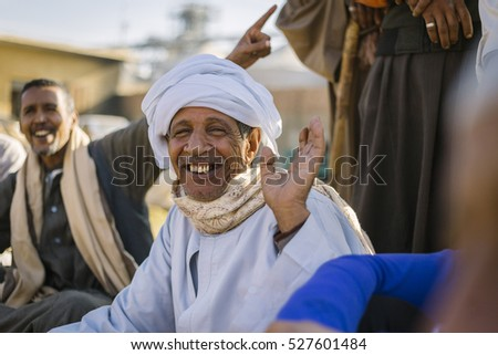 Birqash, Barqash, Imbaba, Giza Governorate, Egypt - November 18, 2016 : Senior happy man at Camel market.