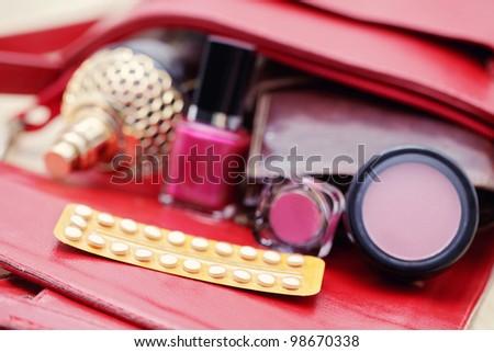 birth control pill in handbag - healthcare and medicine - stock photo