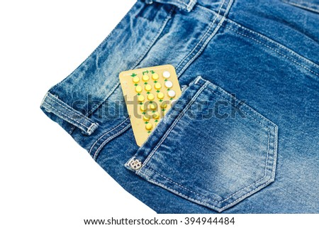 birth-control pill in jeans pocket skirt. - stock photo