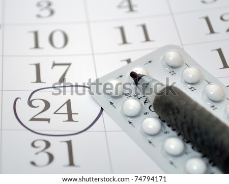 Birth control pills and pen closeup - stock photo