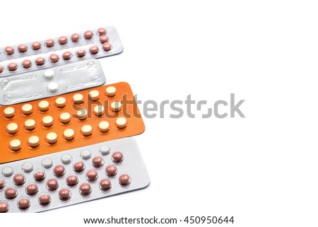 Birth control pills. Morning-after pill and oral contraceptive strips can prevent abortion problems. Blisters of drugs on white background. - stock photo
