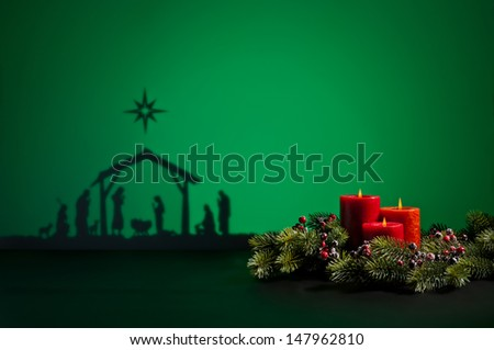 Birth Jesus silhouette of the crib in Bethlehem and candles - stock photo