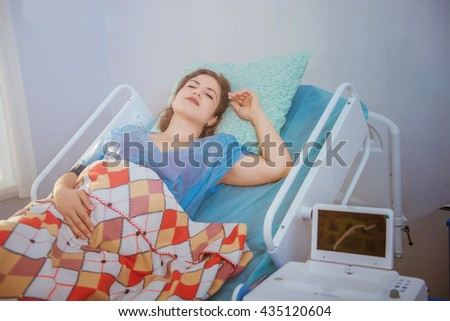 birth, pregnant woman in hospital - stock photo