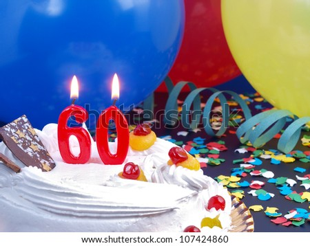 Birthday-anniversary cake with red candle showing Nr. 60 - stock photo