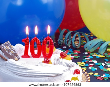 Birthday-anniversary cake with red candle showing Nr. 100