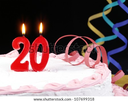 Birthday-anniversary cake with red candle showing Nr. 20 - stock photo