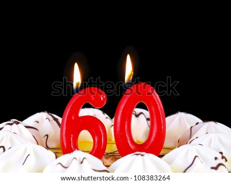 Birthday-anniversary cake with red candles showing Nr. 60 - stock photo