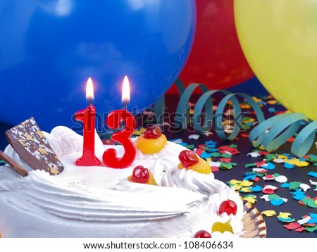 Birthday-anniversary cake with red candles showing Nr. 13 - stock photo