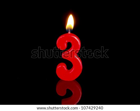 Birthday-anniversary candles showing Nr. 3 - stock photo