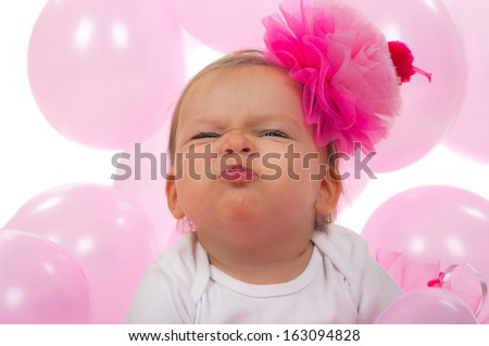 Birthday baby making ugly face expression - stock photo
