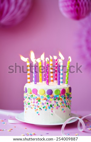 Birthday cake against a party background