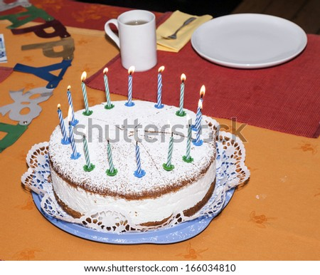 birthday cake at the table early morning ready for celebration - stock photo